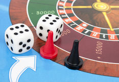 Gambling dice and roulette Stock Images