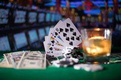 gambling, fortune, game and entertainment concept - close up of casino chips and whisky glass on table royalty free stock photos