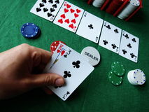 Gambling games. Playing cards at human hands Royalty Free Stock Images