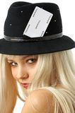 Gambling girl. Lovely blond in hat with joker card Royalty Free Stock Photography