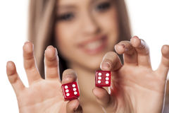 Gambling girl Stock Image
