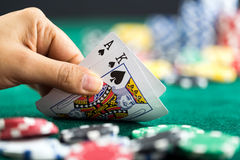 Gambling Hand Holding Best Game Card Series and Money Chips Stock Images