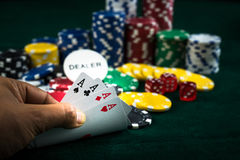 Gambling Hand Holding Best Game Card Series and Money Chips Royalty Free Stock Photography