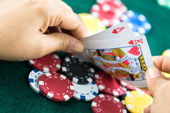 Gambling Hand Holding Best Game Card Series and Money Chips Royalty Free Stock Photos