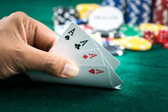Gambling Hand Holding Best Game Card Series and Money Chips Stock Image