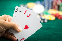 Gambling Hand Holding Best Game Card Series and Money Chips Stock Photo
