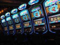 Row of slot machines stock image
