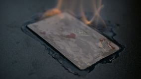 Gambling harm. Abstract ace of hearts burns. On black background hd slow motion footage for you ideas stock video