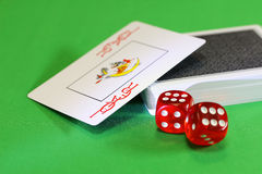 Gambling. Joker. Dice. Royalty Free Stock Photography