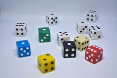 Gambling. Large group of gambling cubes on the white background royalty free stock photo