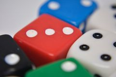Gambling. Large group of gambling cubes on the white background stock photos