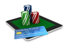 Gambling on line. One portable computer with poker fiches and a credit card (3d render Royalty Free Stock Photo