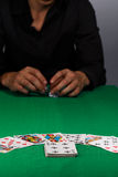 Gambling man in black shirt with dices in hands at playing table Royalty Free Stock Images