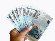 Gambling money !. Holding notes of 20 euros royalty free stock photos
