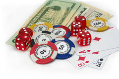 Gambling money, dice and cards. Playing cards and chips isolated on white background Stock Images