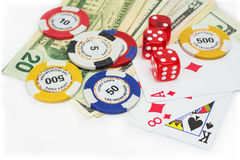 Gambling money, dice and cards. Playing cards and chips  on white background Stock Image