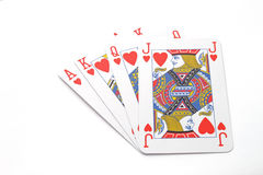 Gambling with playing cards. Over a white background Royalty Free Stock Images