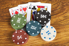 Gambling poker concept with betting chips and playing cards Royalty Free Stock Images