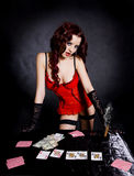 Gambling pretty woman in beautiful lingerie. Stock Photos