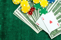 Gambling  Red Dice Poker Cards and Money Chips Stock Images
