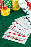 Gambling Red Dice Poker Cards and Money Chips Stock Image