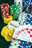 Gambling Red Dice Poker Cards and Money Chips Stock Photo