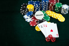 Gambling Red Dice Poker Cards and Money Chips Stock Photos