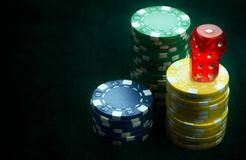 Gambling Red Dices and Money Chips royalty free stock image