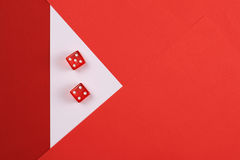 Gambling, risk concept. Two red dice on colorful, geometric background.  Copy space image Royalty Free Stock Images
