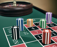 Gambling, roulette game. Close up view of a roulette table with fiches (3d render Stock Image