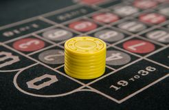 Gambling on a roulette table with yellow chips. Abstract Stock Photo