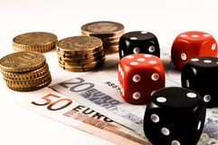 Gambling. A gambling scene with dice and money Royalty Free Stock Photos