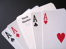 Gambling on the Stock Market. Poker Aces and a stock market card, white on black Stock Photography
