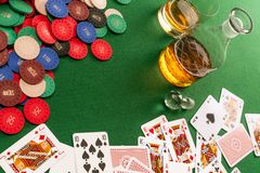 Gambling table with cards and poker chips Stock Image
