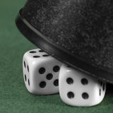 Gambling tension with hidden dice Royalty Free Stock Photos