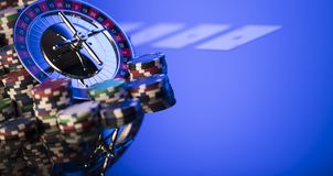 Gambling theme. Place for typography. Roulette and poker chips on blue background. Place for text stock images