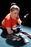 Gambling young woman. Young smiling woman on the poker table Stock Images