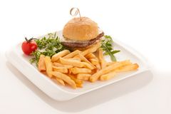 Gamburger with frenchfries on a plate isolated over white backgr royalty free stock photo