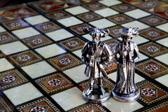 Game. Chess on a chess board stock images