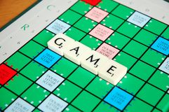 GAME. Scrabble Board With Pieces Spelling GAME Royalty Free Stock Photo