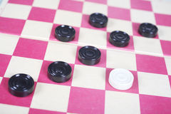 Game. Sports game on a red checker-board with square Royalty Free Stock Image