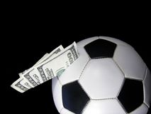 money in soccer ball Royalty Free Stock Images