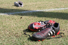 After the Game. Cleats and shin guards left behind royalty free stock image