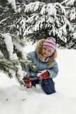 Game. The happy girl plays snowballs Stock Photos