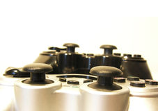 Game on!. Two game controllers close up - shallow depth of field Stock Image