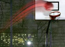 The game. Powerful throw (basketball) at night stock photos