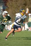 Boys High School Lacrosse. Game action of a boys High School Lacrosse game in Central New jersey Royalty Free Stock Photo