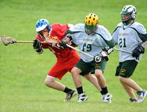 Boys Lacrosse Tournament. Game action of a boys Lacrosse game in a tournament in New Jersey Royalty Free Stock Photo