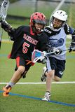 Boys Lacrosse Tournament. Game action of a boys Lacrosse game in a tournament in New Jersey Stock Photo