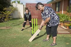The Game of Back Yard Cricket. It is true Aussie tradition to play a version of the professional sport at home. The whole family joins in even the Grandmother stock image
